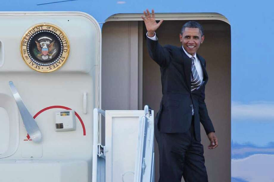 President Barack Obama waves goodbye as he boards Air Force One at the King County International Airport in Seattle on Sept. 25, 2011 Photo: JOE DYER / SEATTLEPI.COM