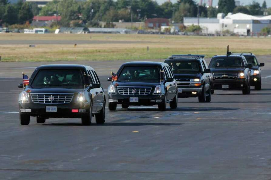 The Presidential Motorcade returns to Air Force One at the King County International Airport in Seat