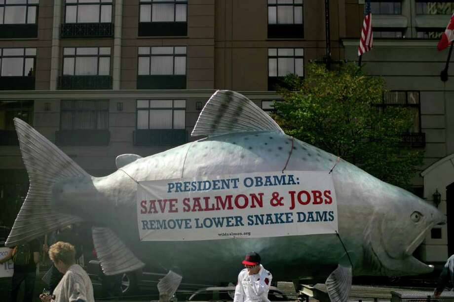 A salmon is carried near the Paramount Theatre. Photo: JORDAN STEAD / FOR SEATTLEPI.COM