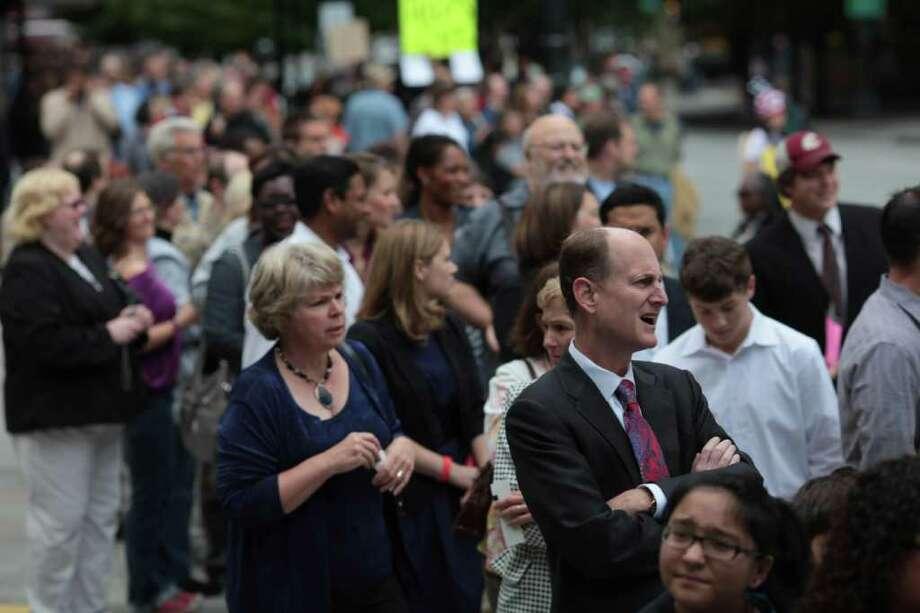 Ticket holders line the sidewalks to hear President Barack Obama speak as protesters clustered on street corners outside shouted for political change. Photo: JORDAN STEAD / FOR SEATTLEPI.COM