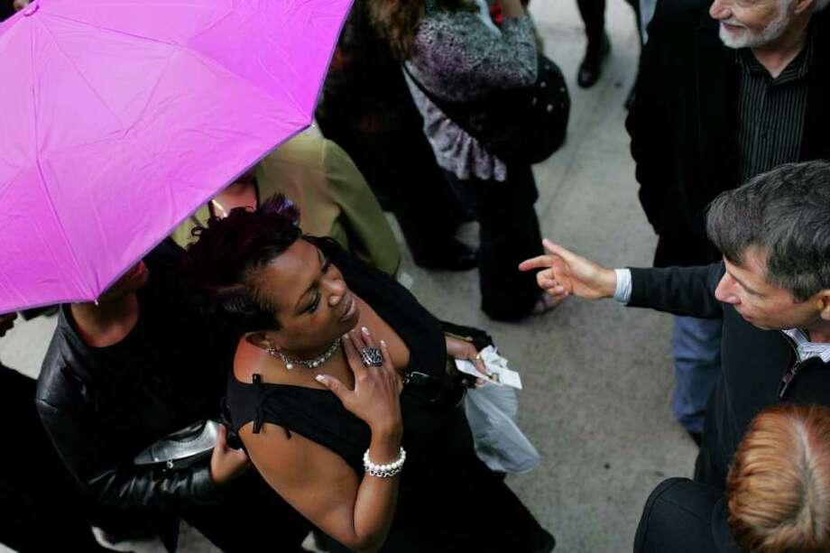Ticket holders debate while waiting in line to hear President Barack Obama speak. Photo: JORDAN STEAD / FOR SEATTLEPI.COM