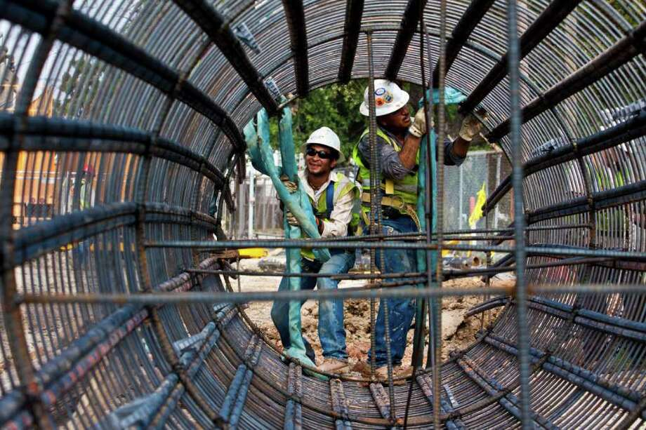 Construction workers work on the continuation of the red line to the north line station, an extension of 5.28 miles. The completion date for the expansion is 2014. Photo: Eric Kayne / © 2011 Eric Kayne