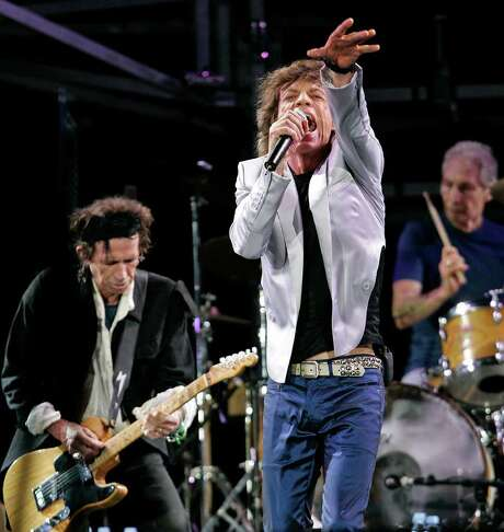 "**FILE**Rolling Stones, from left, Keith Richards, Mick Jagger and Charlie Watts perform at Fenway Park in Boston on Aug. 21, 2005, where the group opened their ""A Bigger Bang"" world tour.  Officials received a deluge of complaints from San Francisco residents who live near SBC Park, where the Rolling Stones played to a packed stadium Sunday night, Nov. 13, 2005. Neighbors complained of windows and floors vibrating.(AP Photo/Winslow Townson) Photo: WINSLOW TOWNSON / AP"