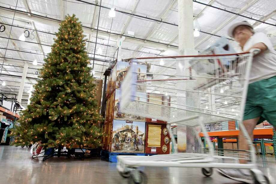 ERIC KAYNE : FOR THE CHRONICLE IT'S BEGINNING TO LOOK A LOT LIKE ... : Costco had its decorations out before Labor Day. Slower sales growth projections have retailers looking to attract early holiday shoppers. Photo: Eric Kayne / © 2011 Eric Kayne