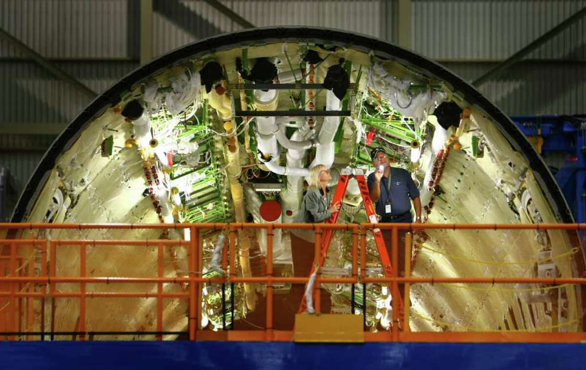 Workers assemble the fuselage of a 787, seen during a tour of the 787 assembly line at the Boeing plant in Everett. Boeing is set to deliver the first 787 to launch customer All Nippon Airways.