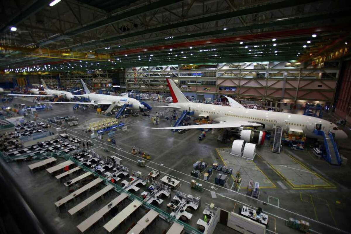 The 787 assembly line is shown with planes being assembled for, from right, Air India, United Airlines, and Ethiopian Airlines.
