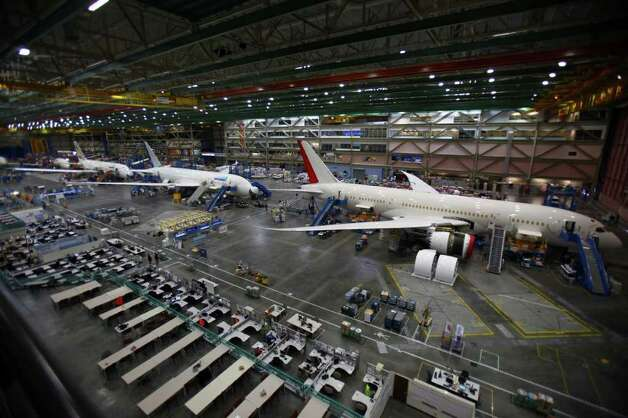 The 787 assembly line is shown with planes being assembled for, from right, Air India, United Airlines, and Ethiopian Airlines during a 787 tour at the Boeing assembly plant in Everett on Sunday, September 25, 2011.