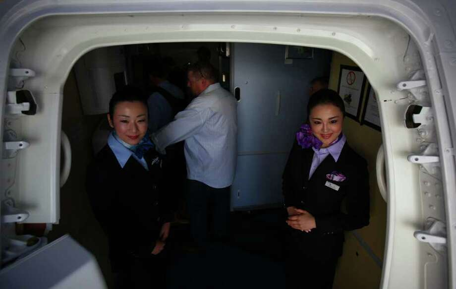 Flight attendants welcome visitors aboard the second 787 destined for launch customer ANA during a 787 tour at the Boeing assembly plant in Everett. Photo: JOSHUA TRUJILLO / SEATTLEPI.COM