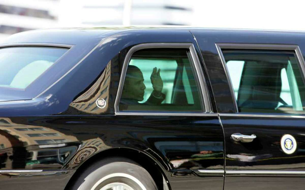 President Barack Obama waves at people as he leaves downtown Seattle, Sunday, Sept. 25, 2011, after a fundraising event at the Paramount Theatre.