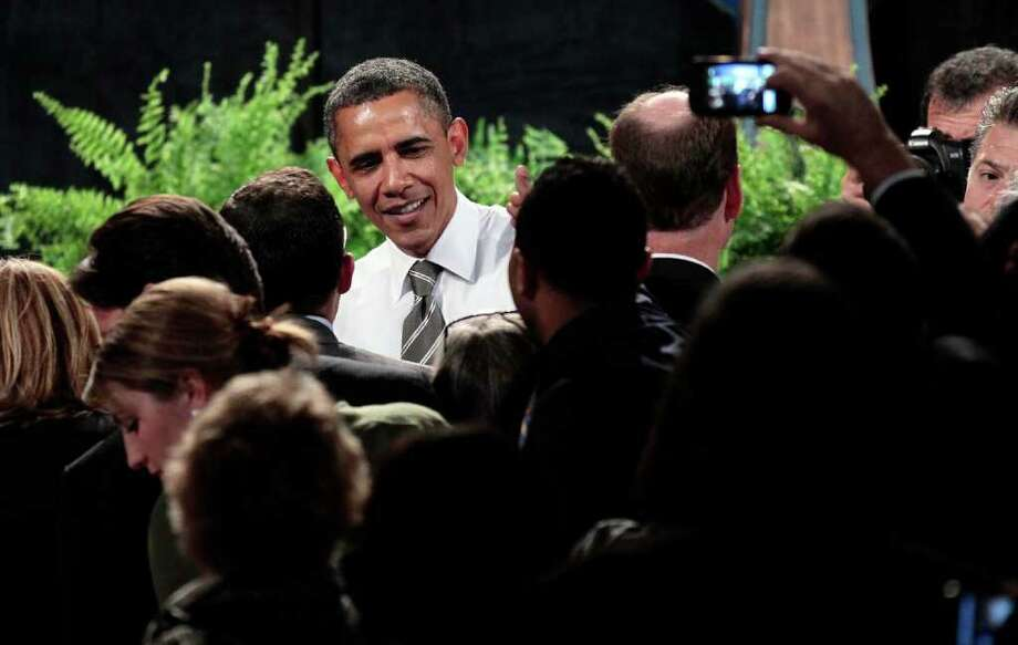 President Barack Obama greets supporters after speaking at a Democratic fundraiser at the Paramount Theatre, Sunday, Sept., 25, 2011, in Seattle, Wash. Photo: Pablo Martinez Monsivais / ASSOCIATED PRESS