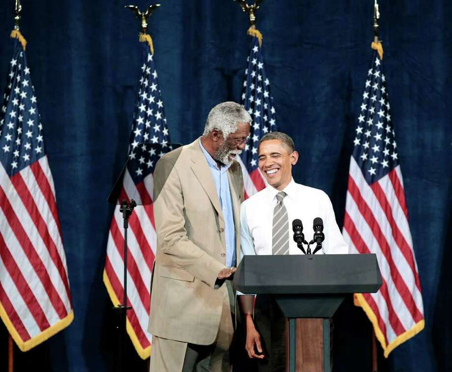 President Barack Obama, right, is introduced by NBA basketball hall-of-famer, Bill Russell, left, during a Democratic fundraiser at the Paramount Theatre, Sunday, Sept., 25, 2011, in Seattle, Wash. Photo: Pablo Martinez Monsivais / ASSOCIATED PRESS