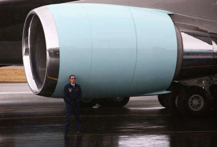 A member of the Air Force crew stands by an Air Force One engine. Photo: JOSHUA TRUJILLO / SEATTLEPI.COM