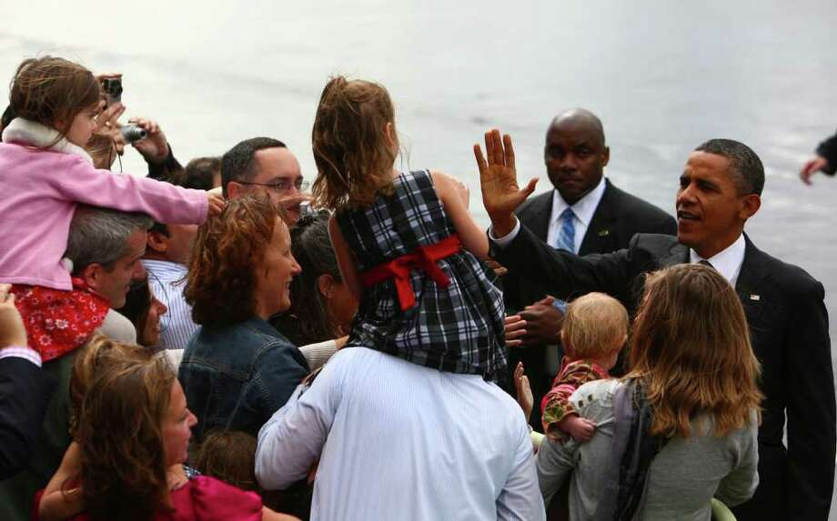 President Barack Obama greets suporters during a brief stop in Seattle. Photo: JOSHUA TRUJILLO / SEATTLEPI.COM