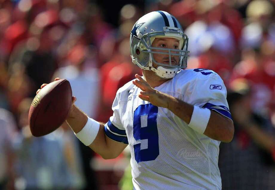 Cowboys quarterback Tony Romo is expected to start tonight against the Redskins despite having a fractured rib. Photo: Marcio Jose Sanchez, Associated Press / AP