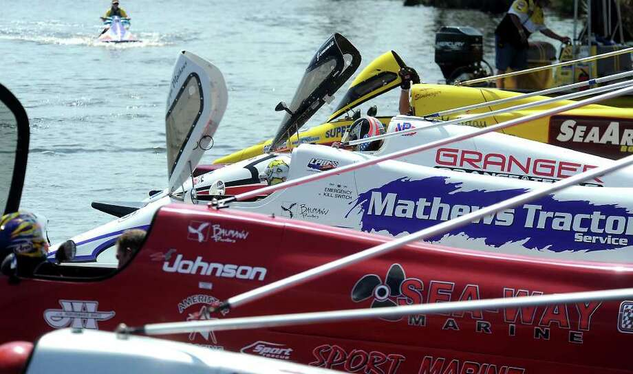 Drivers wait to qualify for the Southern Professional Outboard Racing Tour tunnel boat races, Saturday, September 24, 2011. The races continue on Sunday during the two day event that includes boat races, vendor booths, petting zoo, and water slides.   Tammy McKinley/The Enterprise Photo: TAMMY MCKINLEY