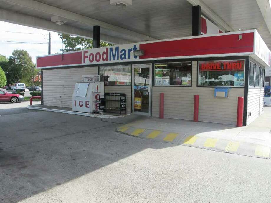 Police say two suspects shot a station clerk at the Food Mart gas station on Lake Street Extension with a pellet gun during a robbery on Sunday night. Photo: Libor Jany