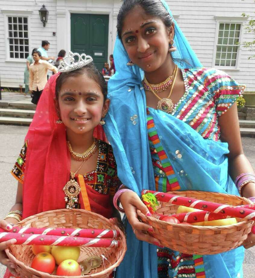 Dancers Vishaka Ravichandran, 11, and her older sister Deepika, 13, at Sunday's 5th annual Heritage India Festival on Town Hall Green. Photo: Mike Lauterborn / Fairfield Citizen contributed