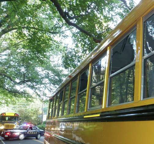 Three windows on this school bus were shattered Monday morning when it struck a low-hanging tree branch on Lyons Plains Road in Westport. Eight Weston students suffered minor injuries from the flying glass, but no one was hospitalized. Photo: Westport Fire Department / Westport News contributed