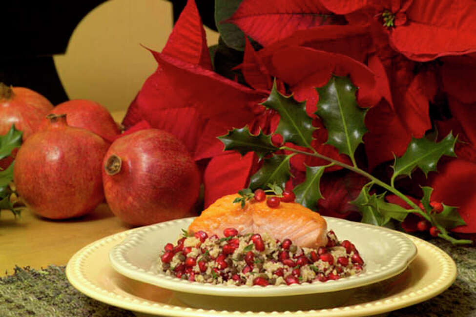 Salmon with Pomegranate Lentil Couscous. See recipe below. (Photo courtesy of the Pomegranate Council.)