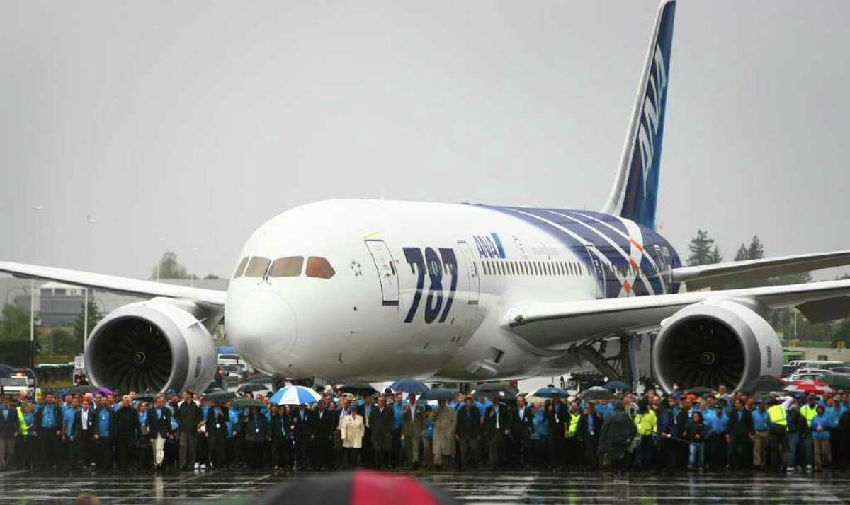 Boeing workers lead a 787 toward a ceremony marking delivery of the first Boeing 787 to launch customer All Nippon Airways on Monday, September 26, 2011 at the Boeing plant in Everett.
