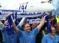 Boeing employees raise scarves during a ceremony marking delivery of the first Boeing 787 to launch customer All Nippon Airways on Monday, September 26, 2011 at the Boeing plant in Everett.