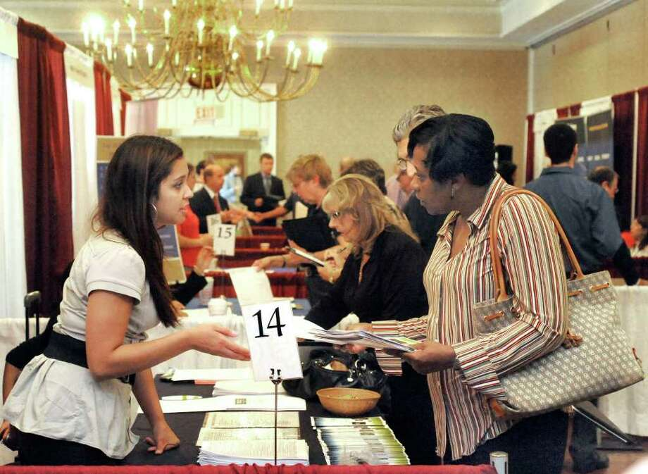 Giselle Colon, of Marrakech Incorporated, left, talks to Eileen Colon, of Danbury, during Career Fair 2011 at the Ethan Allen Inn in Danbury Monday, Sept. 26, 2011. Photo: Michael Duffy