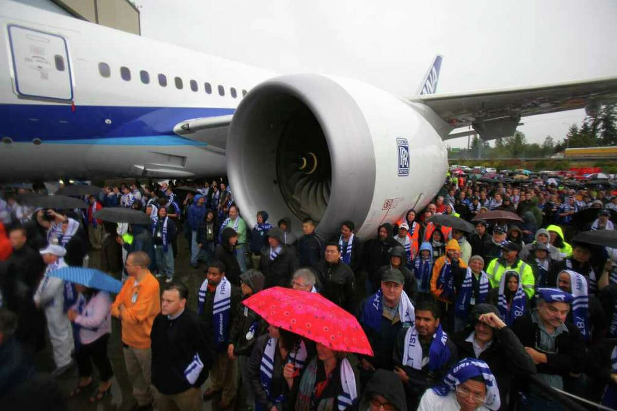 Boeing employees listen during a ceremony marking delivery of the first Boeing 787 to launch customer All Nippon Airways on Monday, at the Boeing plant in Everett.