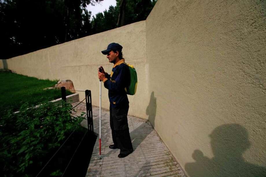 In this photo taken Sept. 7, 2011, Jose Sebastian is photographed by Guatemala's Rodrigo Telon Yucute at a park in Mexico City. Photo: Rodrigo Telon Yucute, Associated Press / AP