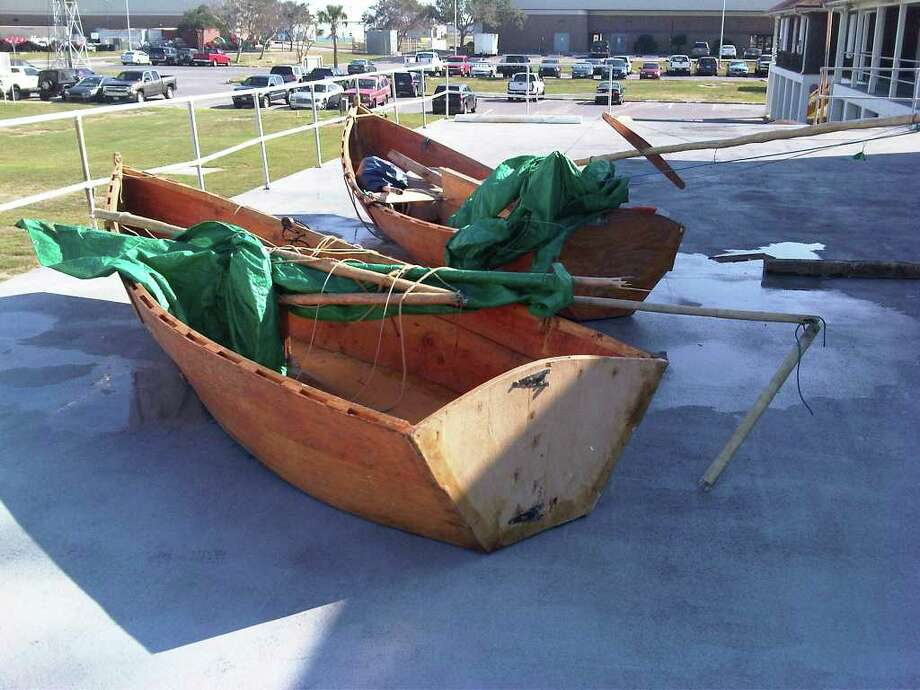These wooden boats are about 10 to 15 feet long and used green tarps as  sails. They appeared to be handmade, Coast Guard officialssaid. Photo: US Coast Guard