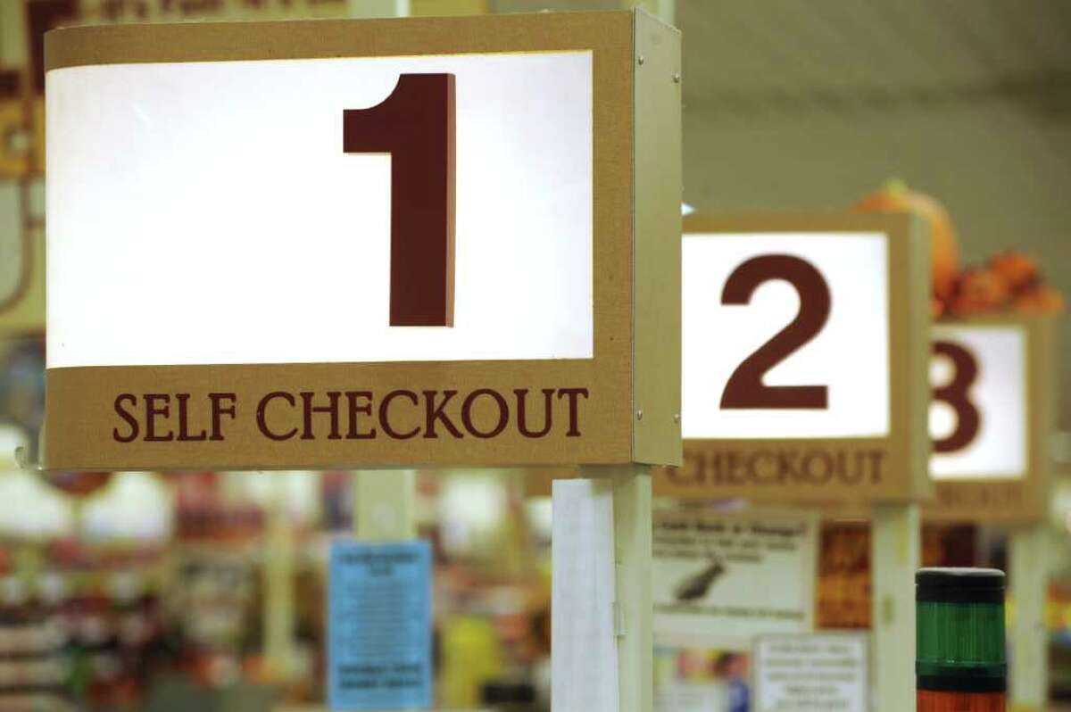 In this Sept. 23, 2011 photo, a row of self checkout lines are available at a Big Y supermarket in Manchester, Conn. A growing number of supermarket chains are bagging their self-serve checkout lanes, saying they can offer better customer service when clerks help shoppers directly. Big Y Foods, which has more than 60 southern New England locations, recently became the latest to announce it's phasing them out. (AP Photo/Jessica Hill)