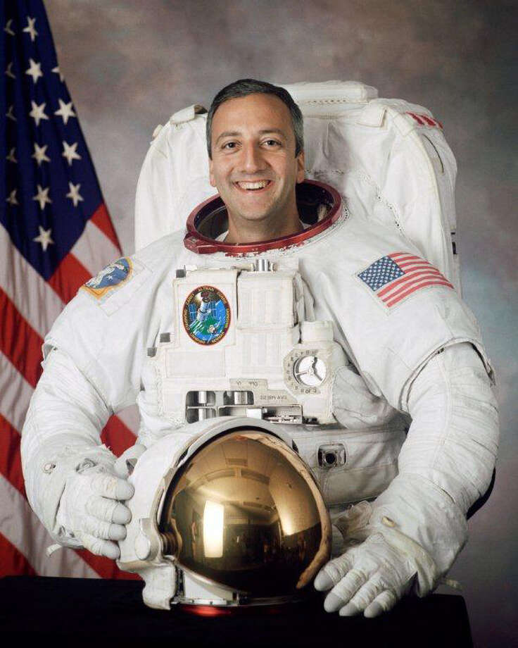 Astronaut Michael J. Massimino, a veteran of about 572 hours in space on two separate missions, will visit the Discovery Museum in Bridgeport on Oct. 8. Photo: Contributed Photo