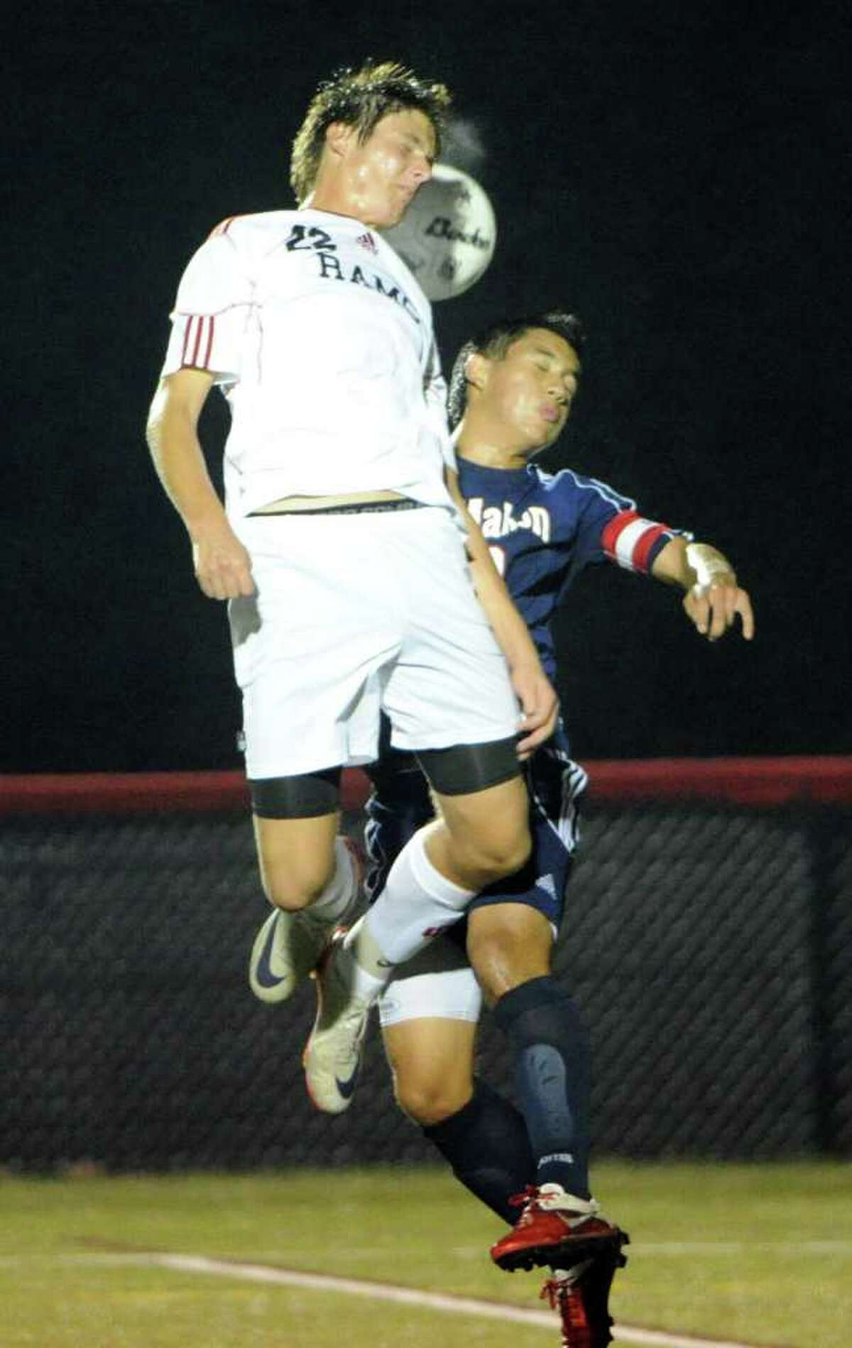 New Canaan's Nicolas Deambrosio and McMahon's Dilman Recinos in action as New Canaan High School hosts Brien McMahon in a boys soccer game at New Canaan's Dunning Stadium, Conn., Sept. 26, 2011.