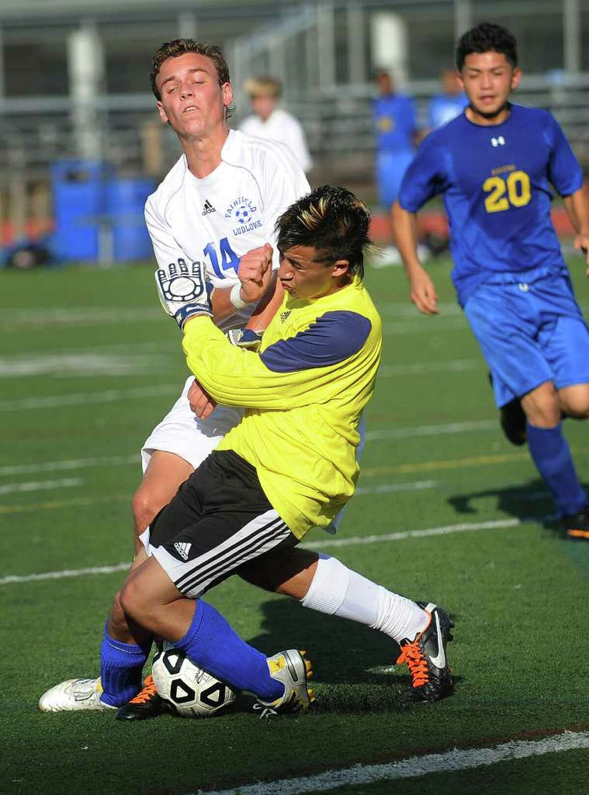 Ludlowe's Henry Kreiter collides with Harding keeper Adolfo Barragas during the first half of the Falcon's home victory on Monday, September 26, 2011.