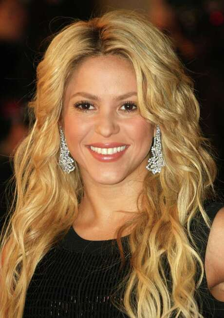 FILE - In this Jan. 22, 2011 file photo, Colombian singer, songwriter, musician, Shakira arrives at the Cannes festival palace, to take part in the NRJ Music awards ceremony, in Cannes, southeastern France. Shakira, a seven-time Latin Grammy winner, will be honored Nov. 9 at the 12th annual Tribute Gala in Las Vegas for her artistic and philanthropic contributions. Friends and notable artists will salute her with their own versions of her songs during the gala. (AP Photo/Lionel Cironneau, File) Photo: Lionel Cironneau / AP2011