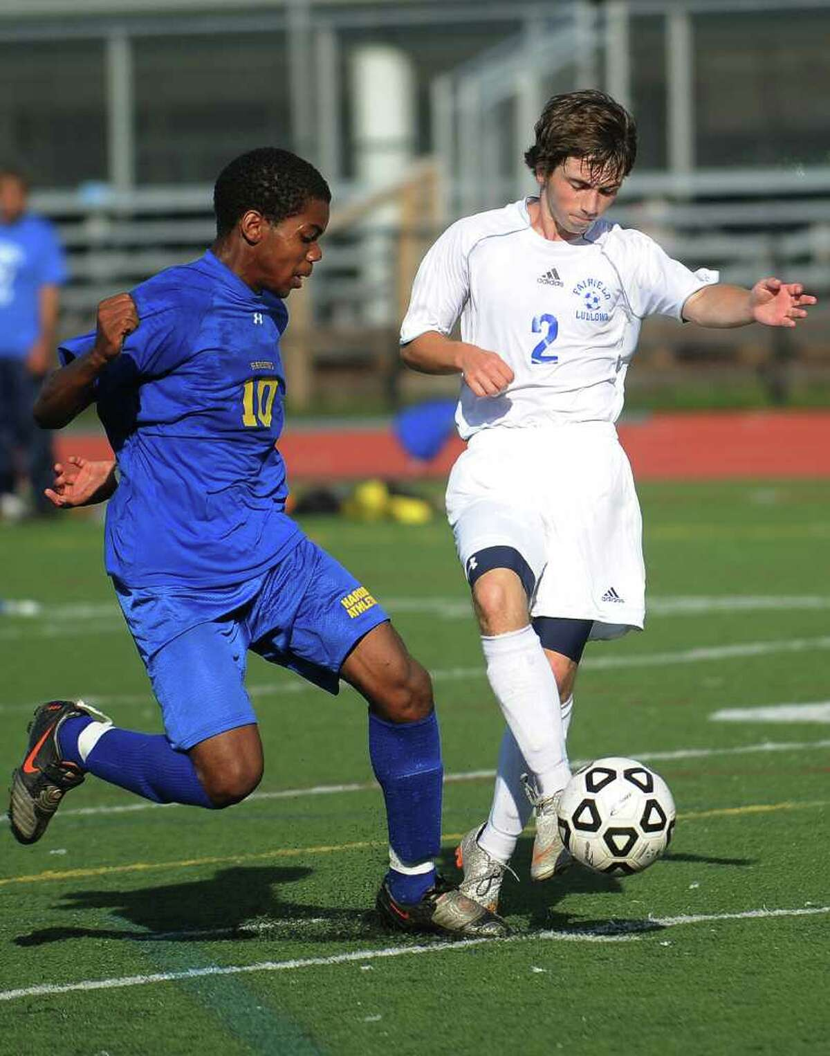 Harding's Ocasio Brown, left, defends Ludlowe's Steven Katz during the first half of the Falcon's home victory on Monday, September 26, 2011.