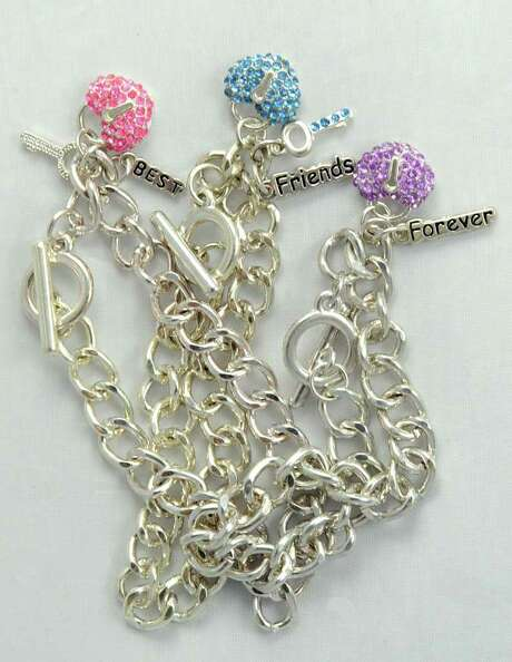"FILE - This undated file photo provided by the U.S. Consumer Product Safety Commission shows three sizes of ""Best Friends"" charm bracelets, which were sold by Claire's Boutiques and recalled in 2010 because of high levels of cadmium, which is a known carcinogen. Efforts by the jewelry industry to voluntarily limit the toxic metal cadmium in children's trinkets are finally coming together, but because the limits are voluntary, there is no automatic penalty if jewelry exceeds them. Federal regulators will, however, use the limits in deciding whether to pursue recalls. (AP Photo/U.S. Consumer Product Safety Commission, File) Photo: Anonymous / AP2010"