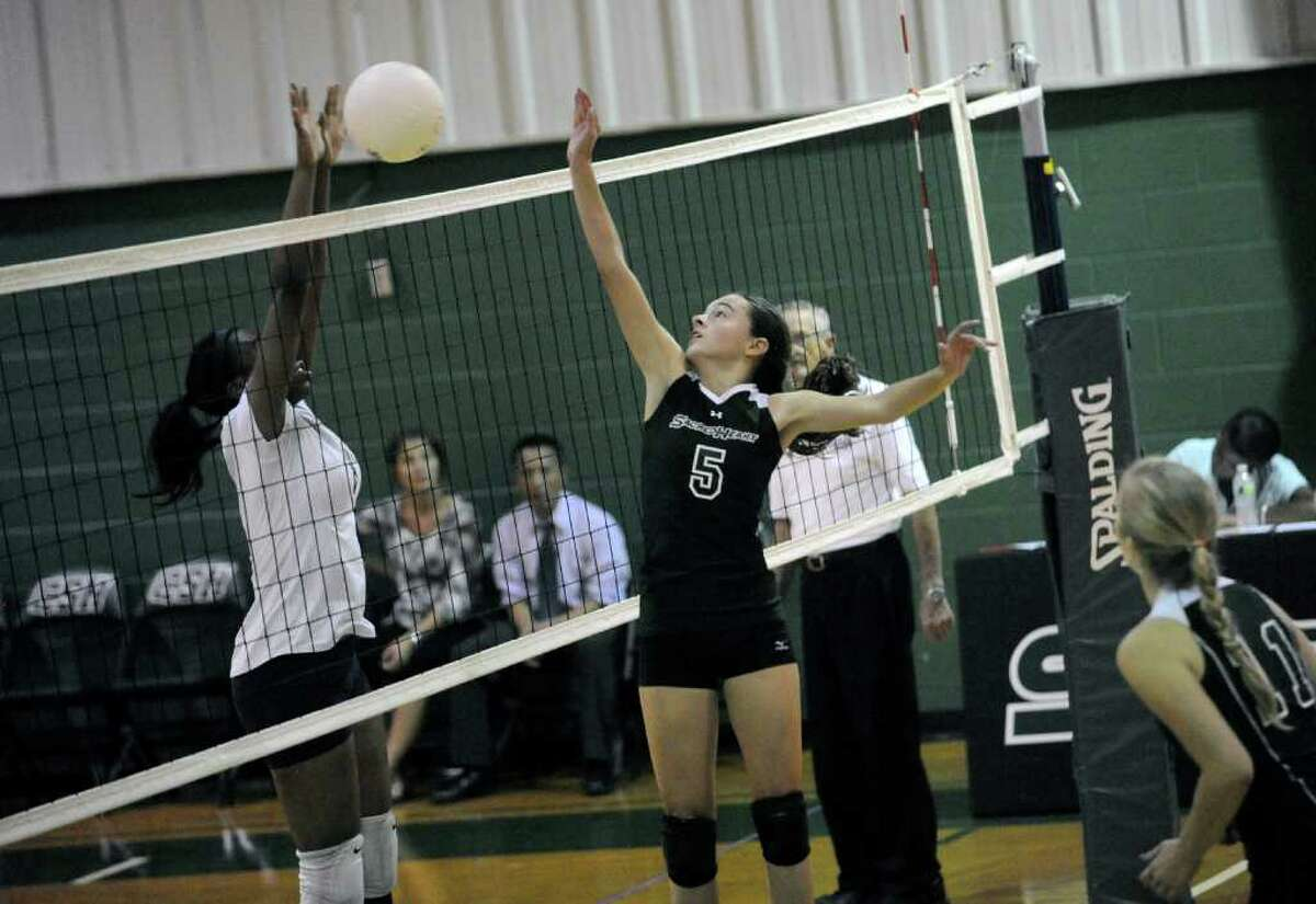 King School's #1 Raven Redd and Sacred Heart's # 5 Grace McKenney at the volleyball game at the Convent ofSacred Heart against Stamford's King School on Monday, Sept. 26, 2011. King School won the game 3 to 1.