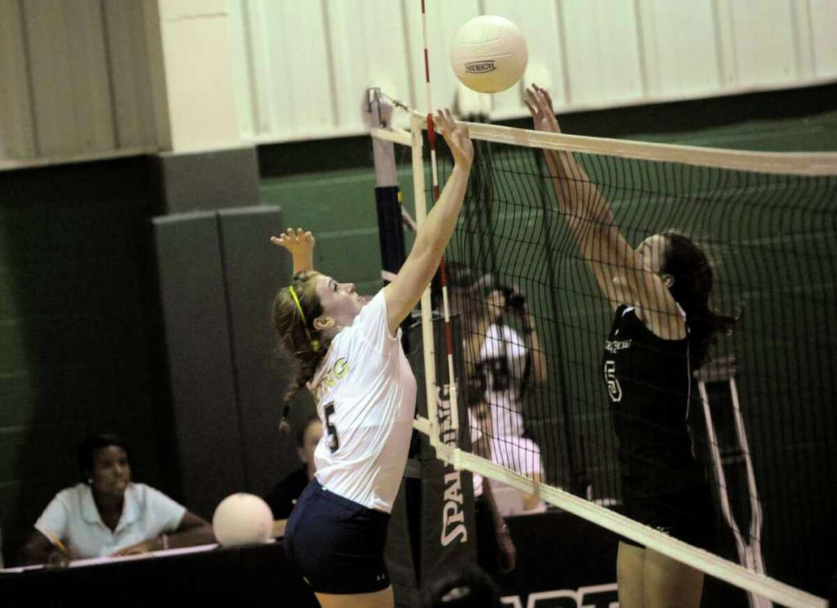 King's #5 Kelsey Luneburg and Sacred Heart's # 5, Grace McKenney at the volleyball game at the Convent of Sacred Heart against Stamford's King School on Monday, Sept. 26, 2011. King School won the game 3 to 1.