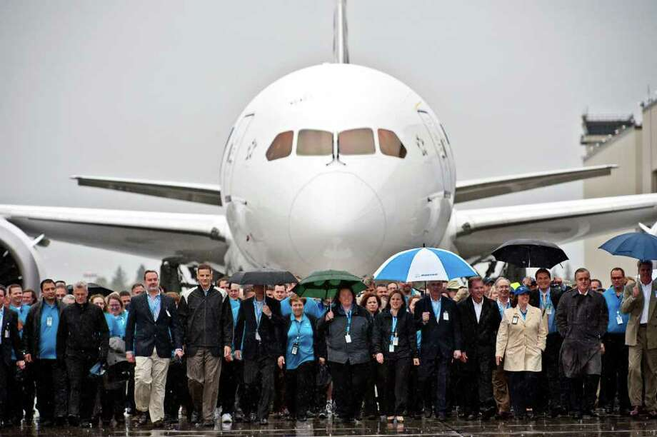 Boeing Co. employees and attendees walk toward the main stage during a ceremony to mark Boeing's delivery of the first 787 Dreamliner to All Nippon Airways Co. (ANA) in Everett, Washington, U.S., on Monday, Sept. 26, 2011. Boeing Co. handed over the first 787 Dreamliner today to end more than three years of delays for a plane that the company says will become a benchmark for decades of technology and passenger amenities. Photographer: Stuart Isett/Bloomberg Photo: Stuart Isett / © 2011 Bloomberg Finance LP