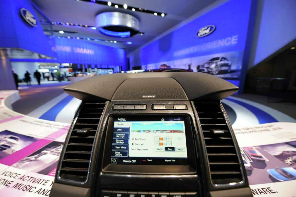 The Ford SYNC screen installed in a center console with voice activated phone, music and information is displayed during the second press preview day at the 2010 North American International Auto Show on January 12, 2010 at Cobo Center in Detroit. The SYNC was developed with Microsoft for use in automobiles. AFP PHOTO/Stan HONDA (Photo credit should read STAN HONDA/AFP/Getty Images)