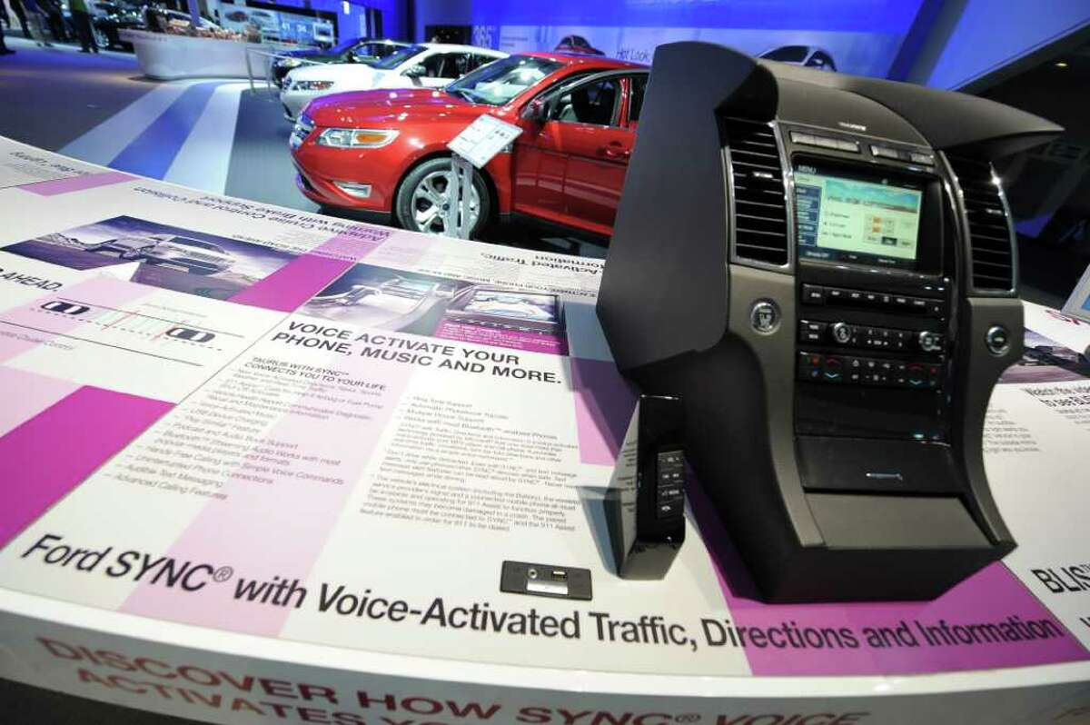 The Ford SYNC screen installed in a center console with voice activated phone, music and information is displayed during the second press preview day at the 2010 North American International Auto Show on Jan. 12, 2010 at Cobo Center in Detroit. The SYNC was developed with Microsoft for use in automobiles. (AFP / Getty Images / Stan Honda)