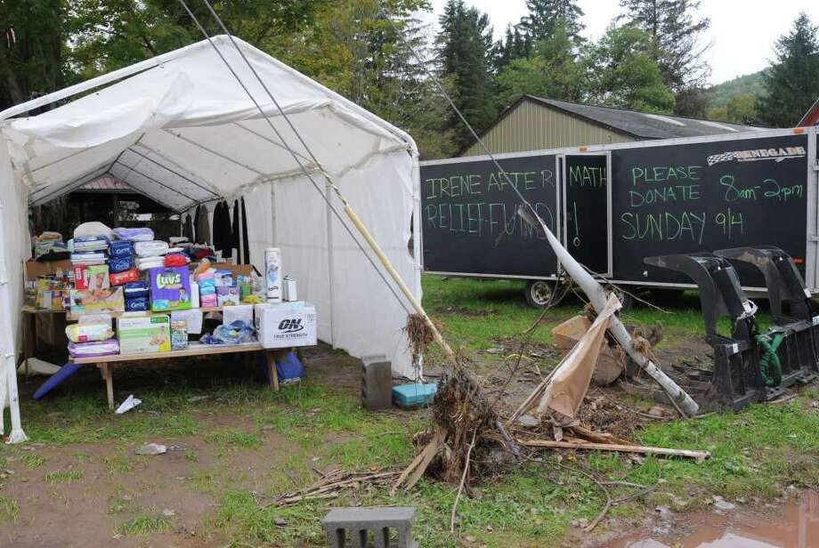 Donated goods are gathered in a car port  in Prattsville, N.Y. on Sept. 8, 2011. The Schoharie Creek flooded the town after tropical storm Irene.(Lori Van Buren / Times Union) Photo: Lori Van Buren