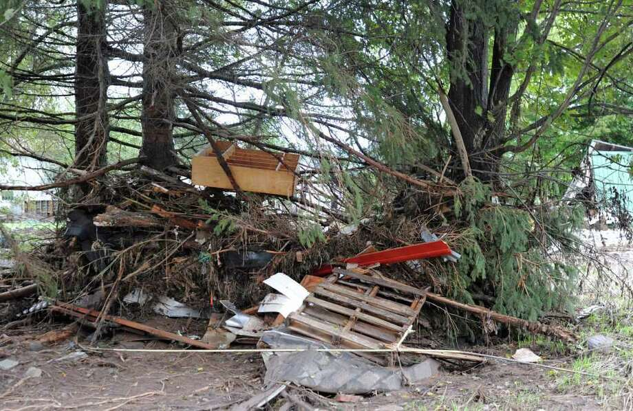 Debris is tangled in trees behind a church on Main St. in Prattsville, N.Y. on Sept. 8, 2011. The Schoharie Creek flooded the town after tropical storm Irene.(Lori Van Buren / Times Union) Photo: Lori Van Buren
