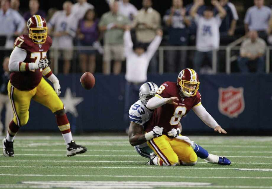 Sept. 26: Cowboys 18, Redskins 16. Cowboys linebacker Anthony Spencer tackles Redskins quarterback Rex Grossman, who lost the ball in the process. The Cowboys recovered the fumble in the closing seconds of the fourth quarter to seal their victory Monday night in Arlington. Photo: Tony Gutierrez, Associated Press / AP