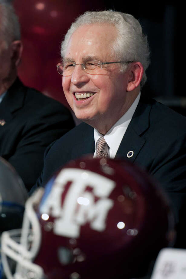 Southeastern Conference commissioner Mike Slive waits for the start of a press conference on Texas A&M's move to the SEC, Monday, Sept. 26, 2011, in College Station. Photo: Dave Einsel, Dave Einsel/Associated Press / FR43584 AP