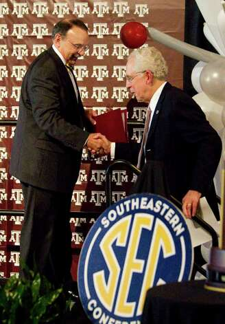 Texas A&M president R. Bowen Loftin, left, welcomes Southeastern Conference commissioner Mike Silve to the stage as Texas A&M celebrates entering the SEC, Monday, Sept. 26, 2011, in Kyle Field in College Station. Photo: Nick De La Torre, Nick De La Torre/Houston Chronicle / © 2011 Houston Chronicle