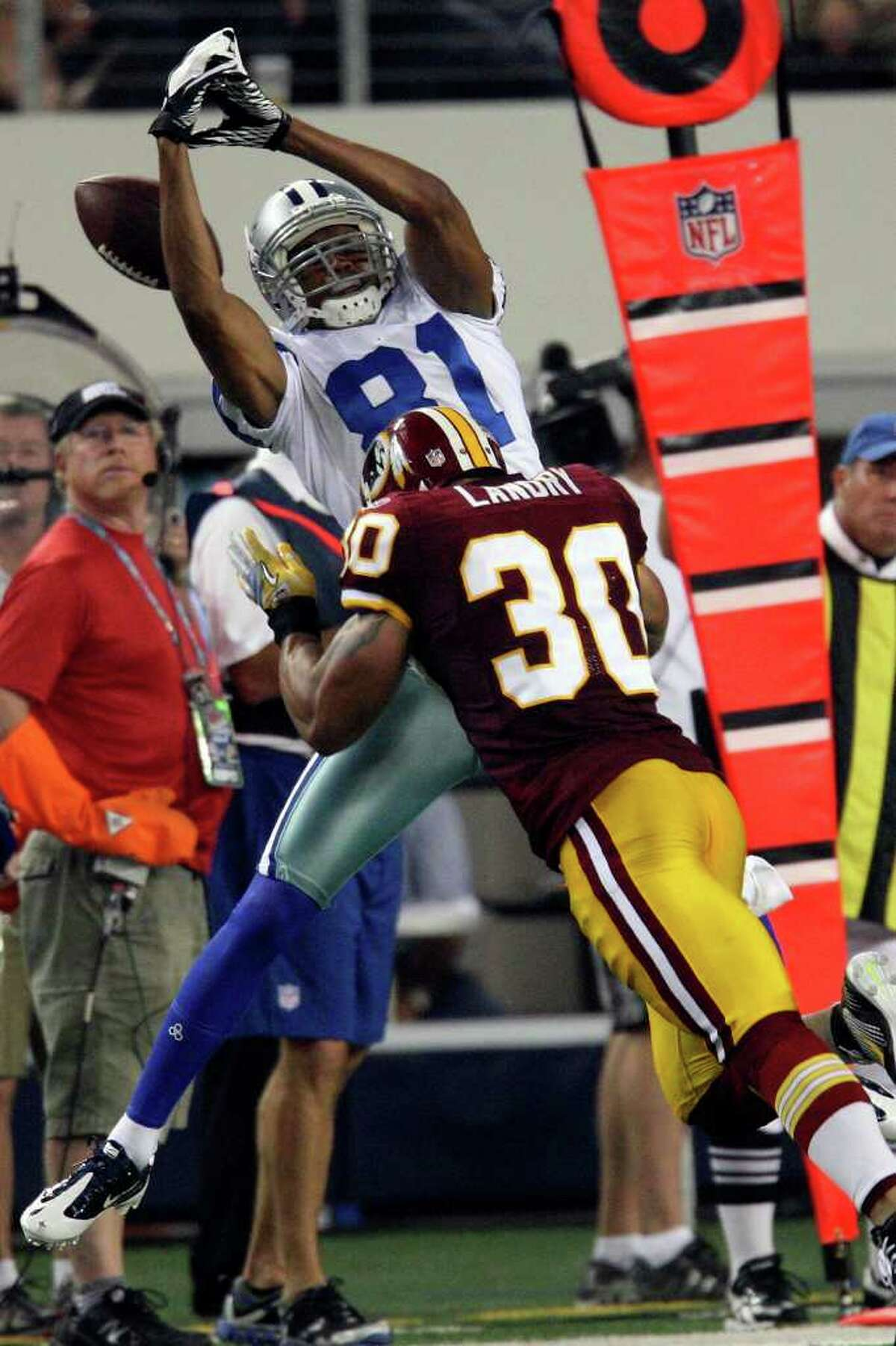 Cowboys wide receiver Laurent Robinson can't hold on to a pass from quarterback Tony Romo as Washington Redskins safety LaRon Landry pressures Robinson at Cowboys Stadium in Arlington on Monday, Sept. 26, 2011.