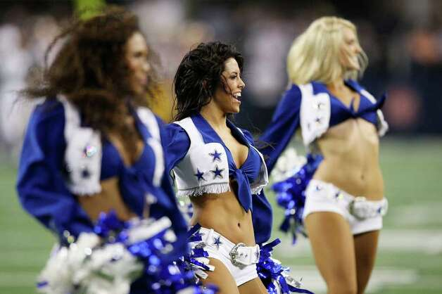 The Dallas Cowboys cheerleaders entertain the crowd at Cowboys Stadium in Arlington on Monday, Sept. 26, 2011. Photo: JERRY LARA, Jerry Lara/glara@express-news.net / SAN ANTONIO EXPRESS-NEWS