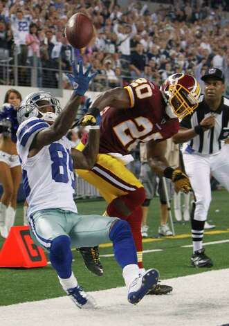 Washington Redskins free safety Oshiomogho Atogwe knocks the pass away from Dallas Cowboys wide receiver Kevin Ogletree during the second half of an NFL football game Monday, Sept. 26, 2011, in Arlington. Photo: L.M. Otero/Associated Press