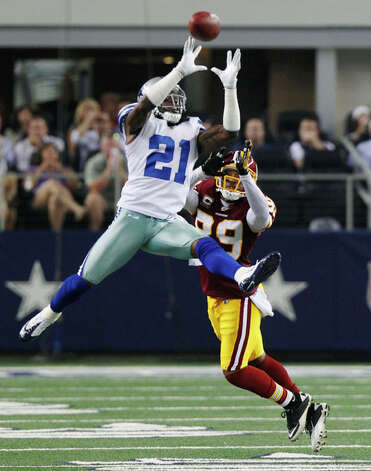 Dallas Cowboys cornerback Mike Jenkins goes up to knock away a pass to Washington Redskins wide receiver Santana Moss during the second half of an NFL football game Monday, Sept. 26, 2011, in Arlington. The pass was incomplete Photo: LM Otero, L.M. Otero/Associated Press / AP